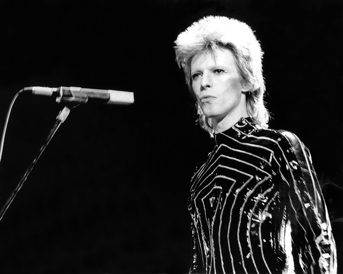 "LOS ANGELES - 1973: Musician David Bowie performs onstage during his ""Ziggy Stardust"" era in 1973 in Los Angeles, California. (Photo by Michael Ochs Archives/Getty Images)"